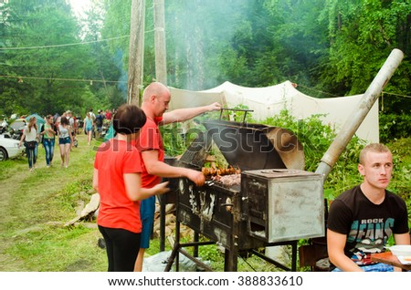 """YAREMCHE, UKRAINE - JULY 5: Unknown people at the 9th public international festival of bikers """"Wild fire"""" on July 5, 2015 - stock photo"""