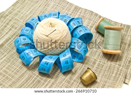yarn and two spools of thread on fabric - stock photo