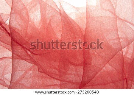 Yarn background  Close-up of a red scarf forming abstract designs. - stock photo
