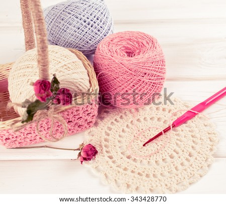 Yarn for crochet and  basket for handmade on white wooden boards in shabby chic style