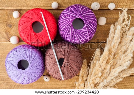 Yarn for knitting and wooden beads on a table. Accessories for knitting. view from above - stock photo