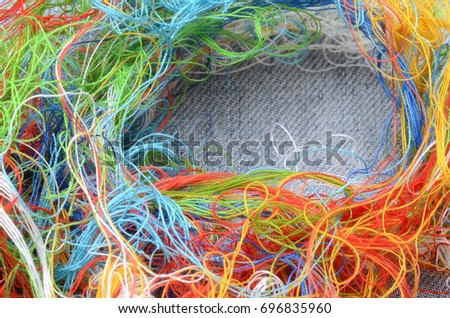 yarn in many colors on a jean template