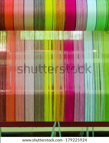 Yarn pattern is set up on the loom bench and ready to weave. - stock photo