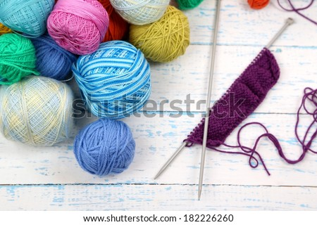 Yarns for knitting on wooden table close-up - stock photo