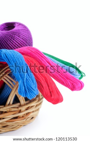 yarns of different colors for embroidery in the basket. Studio isolated. - stock photo