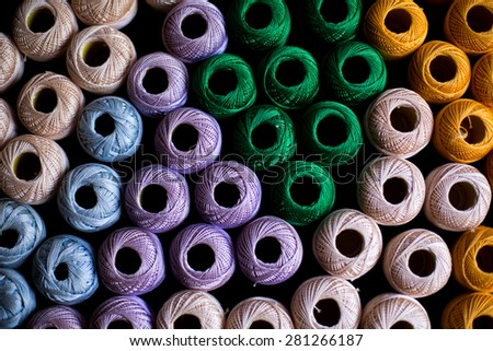 yarns of threads for knitting in different colors background