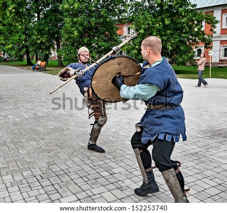 YAROSLAVL, RUSSIA - AUGUST 24: Joust is held on the territory of the monastery in the event of travel around the Golden Ring of Russia, Yaroslavl, August 24, 2013.