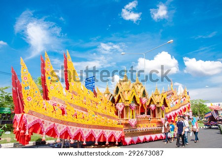 YASOTHON,THAILAND-MAY 15:The car is decorated Head of the serpent in Rocket festival 'Boon Bang Fai' The celebration for plentiful rains during the rice plant season,on May 15,2011 Yasothon,Thailand