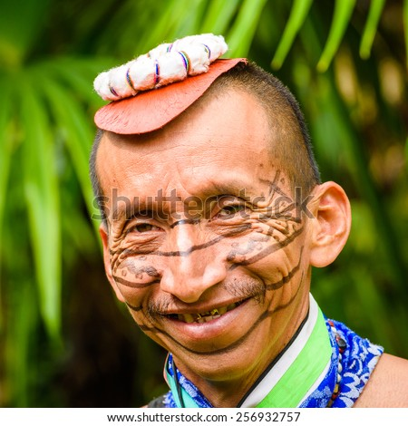 YASUNI, ECUADOR - JAN 4, 2015:  Unidentified Ecuadorian indian portrait. Indigenous indians  are protected by COICA (Coordinator of Indigenous Organizations of the Amazon River Basin)