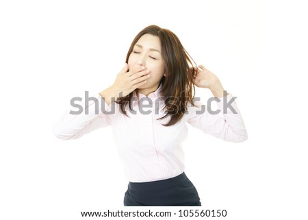 Yawning female office worker