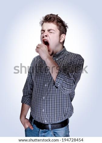 yawning young guy - stock photo