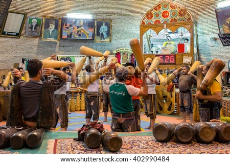 Yazd, Iran - December 17, 2015: Pahlevani and zoorkhaneh rituals.Traditional Iranian system of athletics originally used to train warriors - stock photo