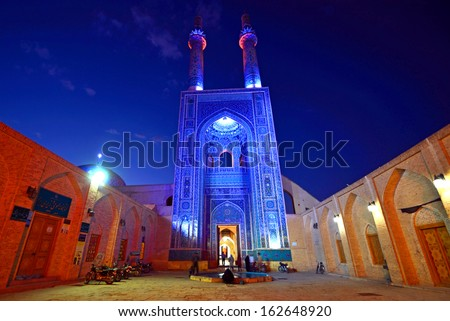 YAZD, IRAN - OCTOBER 11: Jameh Mosque on October 11, 2013 in Yazd, Iran. Jameh Mosque was built in the twelfth century and largely rebuilt between 1324 and 1365.Its minarets are the highest in Iran. - stock photo