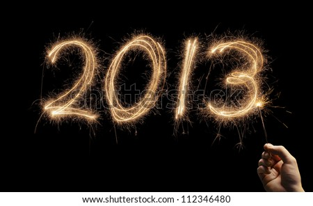 Year number 2013 written with a sparkler. - stock photo