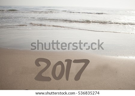 Year 2017 on the beach for background