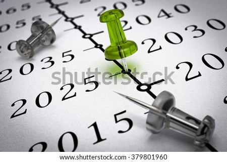 Year 2025 written on a paper with a green pushpin, concept image for business vision or long term prospective. Number two thousand twenty five.  - stock photo