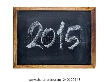 Year 2015 written with chalk on a whiteboard. - stock photo
