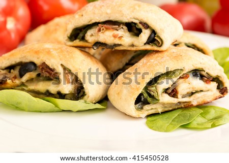 Yeast rolls, homemade healthy baked dough wrapped with vegetables.
