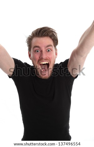 Yeeeaah!! Man screaming with his arms up, wearing a black t-shirt. White background. - stock photo