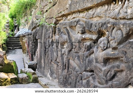 Yeh Pulu is a famous carved cliff face dating back to the 15th century depicting daily scenes in Ubud, Bali, Indonesia - stock photo