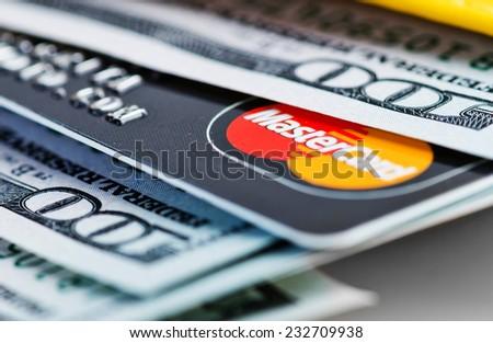 YEKATAERINBURG, RUSSIA - APR 25, 2014: US dollars bills and Mastercard credit card in wallet.  - stock photo