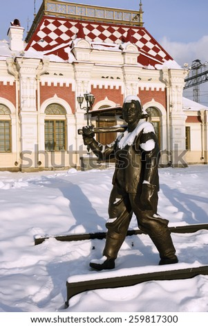 YEKATERINBURG, RUSSIA - JANUARY 1, 2015: Sculpture of railway worker in front of Museum of Sverdlovsk railway. The museum located in the building of first railroad station of Yekaterinburg - stock photo
