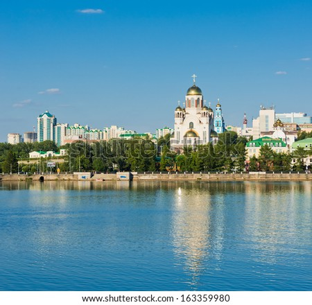 YEKATERINBURG, RUSSIA - JULY 09:   embankment in Yekaterinburg City with Church on Blood in Honour on July 09, 2012. Yekaterinburg is bidding for the 2020 Expo. - stock photo