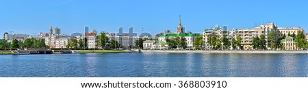 YEKATERINBURG, RUSSIA - JULY 21, 2015: Panorama of Historical center from the city pond. Yekaterinburg was founded in 1723 and now it is the fourth-largest city in Russia with population of 1,428,042. - stock photo