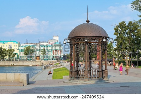 YEKATERINBURG, RUSSIA - JULY 25, 2010: Rotunda on the embankment of city pond. The rotunda was unveiled on December 26, 2008 by the order of city administration. - stock photo