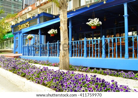 YEKATERINBURG, RUSSIA - JULY 31, 2009. Summer outdoor terrace of James English Pub and Restaurant in center of Yekaterinburg. Facade view. - stock photo