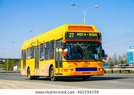 YEKATERINBURG, RUSSIA - MAY 9, 2010: Yellow city bus DAB Citybus at the suburban road.