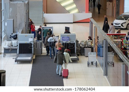 YEKATERINBURG, RUSSIA - SEP 28, 2013: Increased security measures. Screening of passengers at the entrance to the building of the airport Koltsovo - stock photo