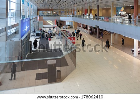 YEKATERINBURG, RUSSIA - SEP 28, 2013: Increased security measures. Screening of passengers at the entrance to the building of the airport Koltsovo