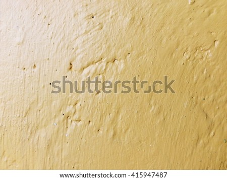 Yellow abstract background texture cement wall
