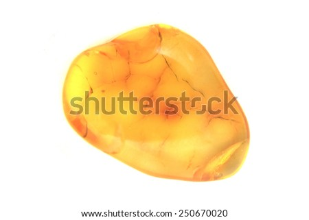 yellow amber mineral isolated on the white background - stock photo