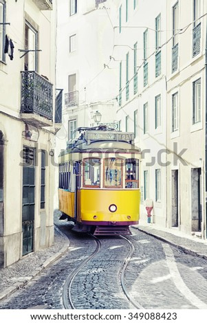 yellow ancient tram on streets of Lisbon, Portugal.  Used toning of the photo