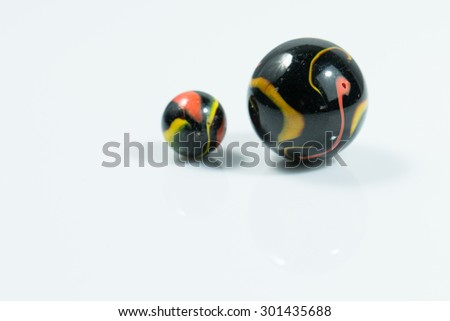 Yellow and black Colorful Marble Ball on white background - stock photo