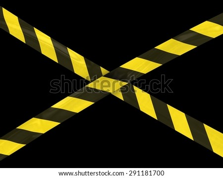 Yellow and Black Striped Barrier Tape Cross on Black Background - stock photo