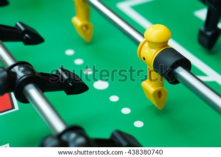 yellow and black table soccer players, selective focus, football table. - stock photo