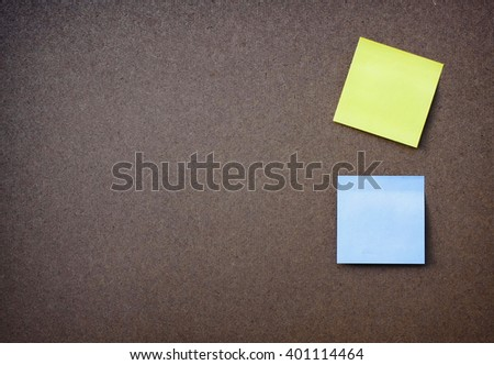 yellow and blue reminder sticky note on wood board.(blank post it note) flat lay.  - stock photo