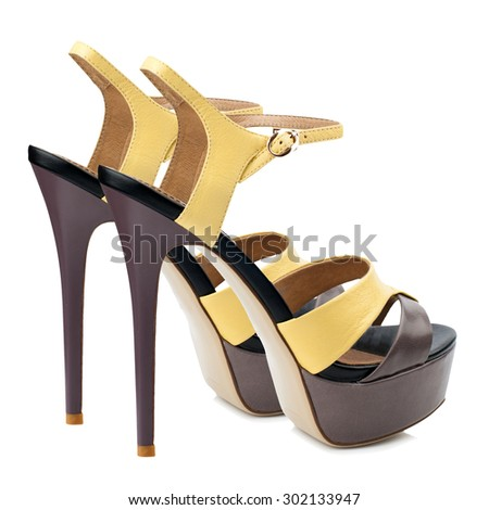 Yellow and brown women shoes isolated on white background