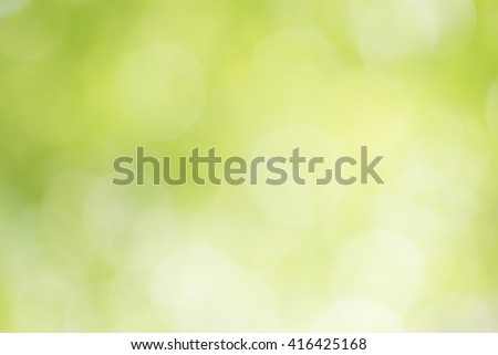 yellow and green light bokeh blurred from tree backgrounds, green and yellow blur background texture - stock photo