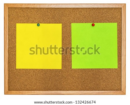 Yellow and light green color note papers pinned on cork board
