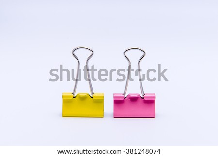 Yellow and Pink binder clips isolated on white background - stock photo