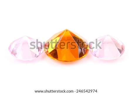 Yellow and pink diamond on a white background - stock photo