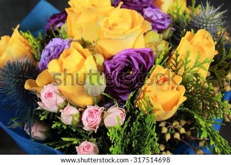 yellow and purple roses wedding bouquet - stock photo