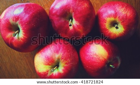 Yellow-and-red apples on a wooden table