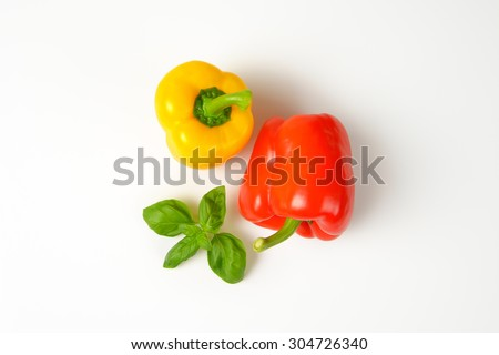 yellow and red bell peppers on white background - stock photo