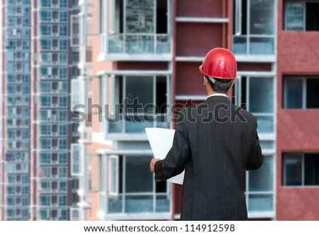 Yellow and red buildings with windows - stock photo