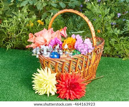 Yellow and red dahlia near Easter basket with flowers and eggs